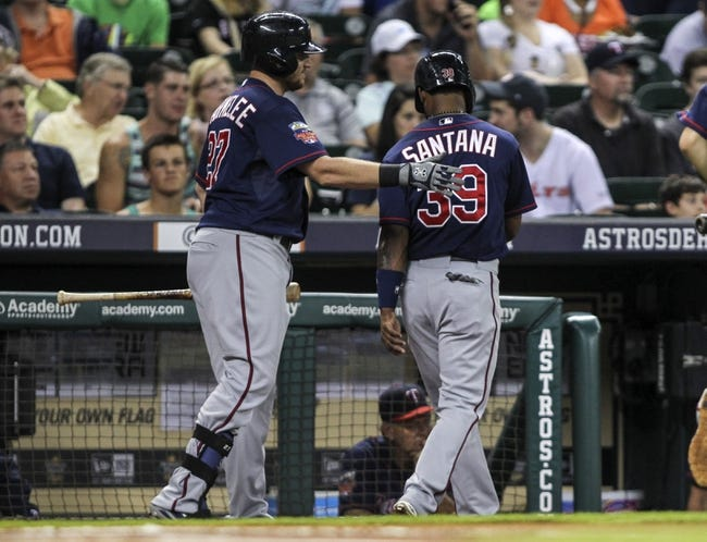Aug 11, 2014; Houston, TX, USA; Minnesota Twins center fielder Danny Santana (39) is congratulated by right fielder Chris Parmelee (27) after scoring a run during the first inning against the Houston Astros at Minute Maid Park. Mandatory Credit: Troy Taormina-USA TODAY Sports