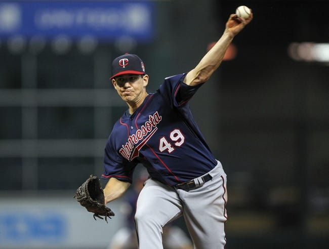 Aug 11, 2014; Houston, TX, USA; Minnesota Twins starting pitcher Tommy Milone (49) delivers a pitch during the third inning against the Houston Astros at Minute Maid Park. Mandatory Credit: Troy Taormina-USA TODAY Sports