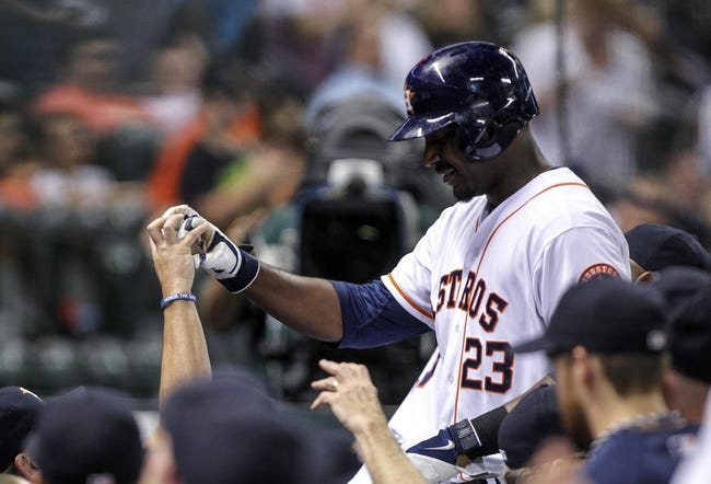 Aug 11, 2014; Houston, TX, USA; Houston Astros designated hitter Chris Carter (23) is congratulated after hitting a home run during the fifth inning against the Minnesota Twins at Minute Maid Park. Mandatory Credit: Troy Taormina-USA TODAY Sports
