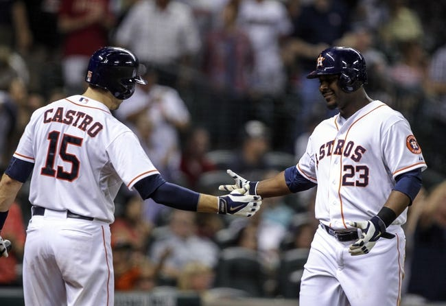 Aug 11, 2014; Houston, TX, USA; Houston Astros designated hitter Chris Carter (23) is congratulated by catcher Jason Castro (15) after hitting a home run during the fifth inning against the Minnesota Twins at Minute Maid Park. Mandatory Credit: Troy Taormina-USA TODAY Sports