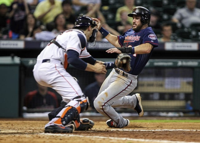 Aug 11, 2014; Houston, TX, USA; Minnesota Twins third baseman Trevor Plouffe (24) is out at home plate as Houston Astros catcher Jason Castro (15) applies the tag during the eighth inning at Minute Maid Park. Mandatory Credit: Troy Taormina-USA TODAY Sports