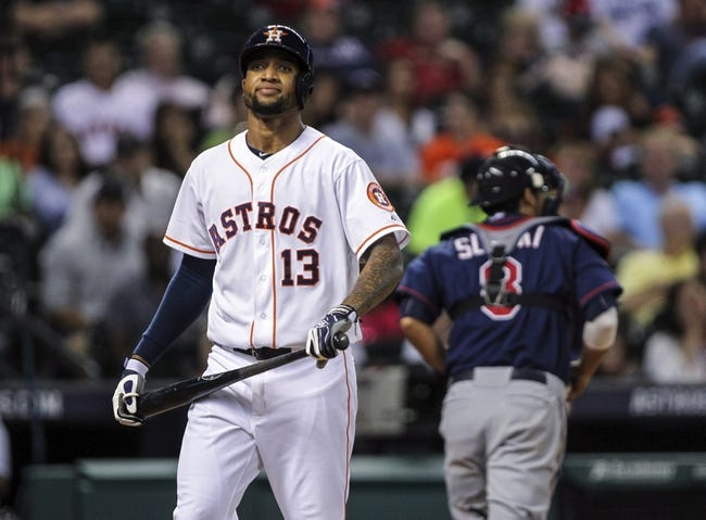 Aug 11, 2014; Houston, TX, USA; Houston Astros left fielder Domingo Santana (13) reacts after striking out during the eighth inning against the Minnesota Twins at Minute Maid Park. Mandatory Credit: Troy Taormina-USA TODAY Sports