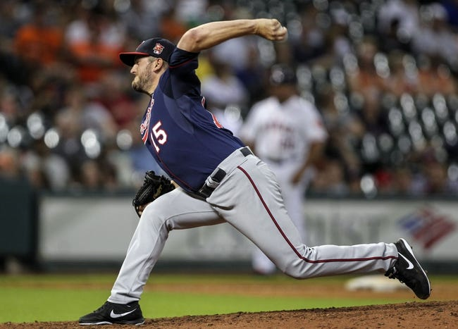 Aug 11, 2014; Houston, TX, USA; Minnesota Twins relief pitcher Glen Perkins (15) pitches during the ninth inning against the Houston Astros at Minute Maid Park. The Twins defeated the Astros 4-2 Mandatory Credit: Troy Taormina-USA TODAY Sports