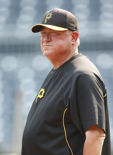 Aug 7, 2014; Pittsburgh, PA, USA; Pittsburgh Pirates manager Clint Hurdle (13) looks on during batting practice before the Pirates host the Miami Marlins  at PNC Park. The Pirates won 7-2. Mandatory Credit: Charles LeClaire-USA TODAY Sports