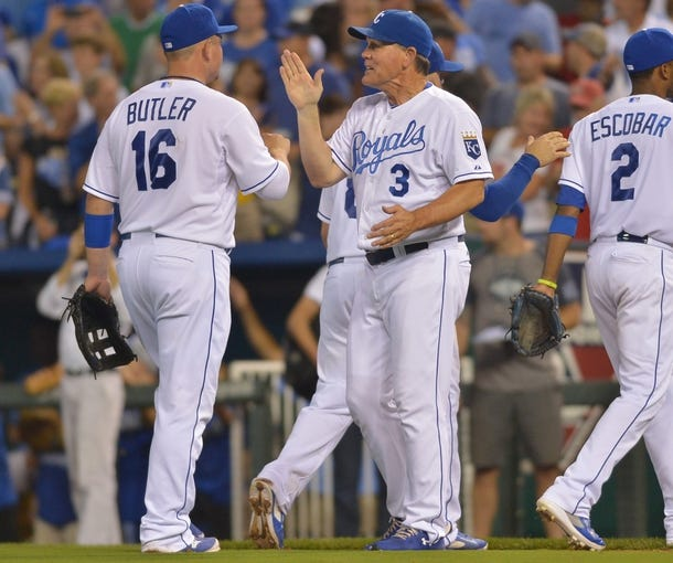 Aug 9, 2014; Kansas City, MO, USA; Kansas City Royals designated hitter Billy Butler (16) is congratulated by manager Ned Yost (3) after the game against the San Francisco Giants at Kauffman Stadium. The Royals won 5-0. Mandatory Credit: Denny Medley-USA TODAY Sports