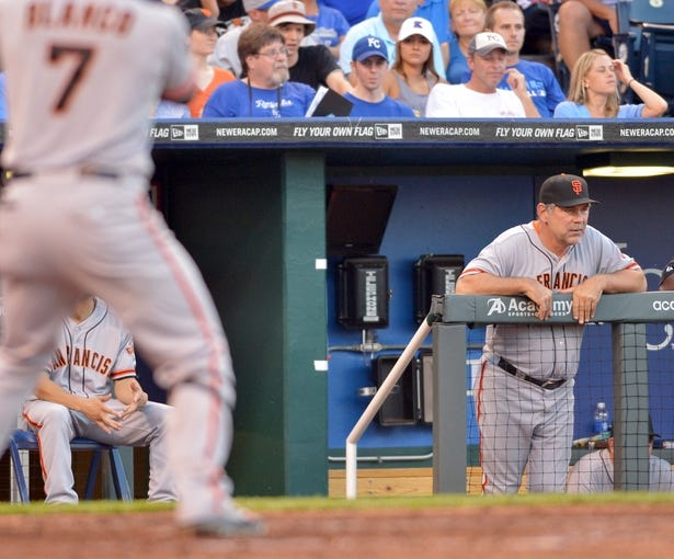 Aug 9, 2014; Kansas City, MO, USA; San Francisco Giants manager Bruce Bochy (15) watches play from the dugout in the seventh inning against the Kansas City Royals at Kauffman Stadium. The Royals won 5-0. Mandatory Credit: Denny Medley-USA TODAY Sports