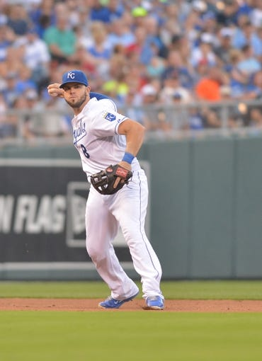 Aug 9, 2014; Kansas City, MO, USA; Kansas City Royals third baseman Mike Moustakas (8) fields a ground ball and throws to first base in the seventh inning against the San Francisco Giants at Kauffman Stadium. The Royals won 5-0. Mandatory Credit: Denny Medley-USA TODAY Sports