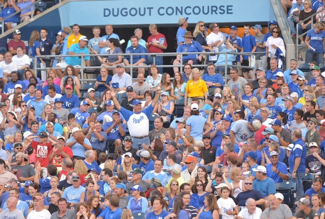 Aug 9, 2014; Kansas City, MO, USA; A Kansas City Royals fan proudly displays a caught foul ball early in the game against the San Francisco Giants at Kauffman Stadium. The Royals won 5-0. Mandatory Credit: Denny Medley-USA TODAY Sports