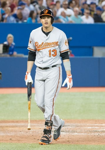 Aug 7, 2014; Toronto, Ontario, CAN; Baltimore Orioles third baseman Manny Machado (13) reacts to striking out in a game against the Toronto Blue Jays at Rogers Centre. The Baltimore Orioles won 2-1. Mandatory Credit: Nick Turchiaro-USA TODAY Sports