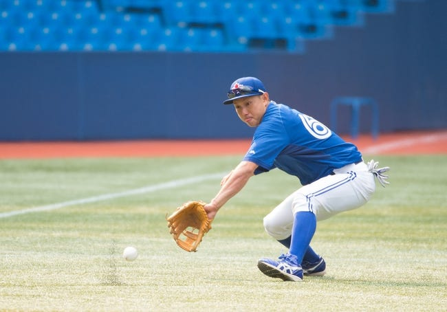 Aug 7, 2014; Toronto, Ontario, CAN; Toronto Blue Jays second baseman Munenori Kawasaki (66) fields a ball during batting practice before a game against the Baltimore Orioles at Rogers Centre. The Baltimore Orioles won 2-1. Mandatory Credit: Nick Turchiaro-USA TODAY Sports