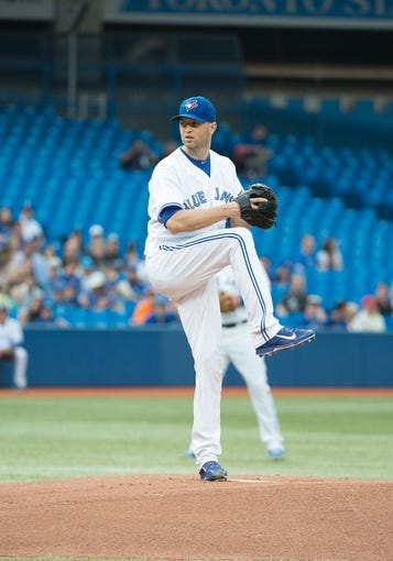 Aug 7, 2014; Toronto, Ontario, CAN; Toronto Blue Jays starting pitcher J.A. Happ (48) throws a pitch in a game against the Baltimore Orioles at Rogers Centre. The Baltimore Orioles won 2-1. Mandatory Credit: Nick Turchiaro-USA TODAY Sports