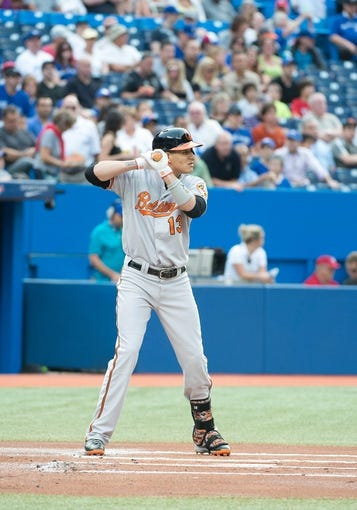 Aug 7, 2014; Toronto, Ontario, CAN; Baltimore Orioles third baseman Manny Machado (13) gets ready to hit in a game against the Toronto Blue Jays at Rogers Centre. The Baltimore Orioles won 2-1. Mandatory Credit: Nick Turchiaro-USA TODAY Sports
