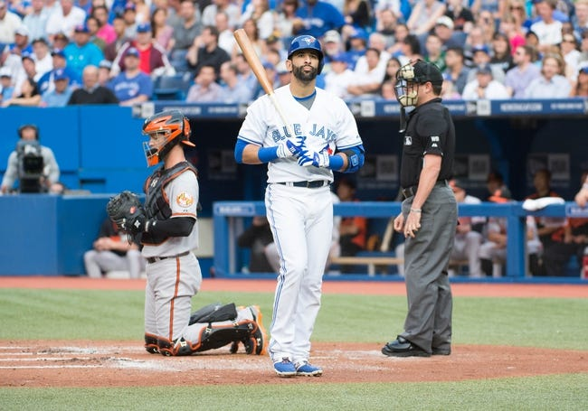 Aug 7, 2014; Toronto, Ontario, CAN; Toronto Blue Jays right fielder Jose Bautista (19) reacts to striking out in a game against the Baltimore Orioles at Rogers Centre. The Baltimore Orioles won 2-1. Mandatory Credit: Nick Turchiaro-USA TODAY Sports