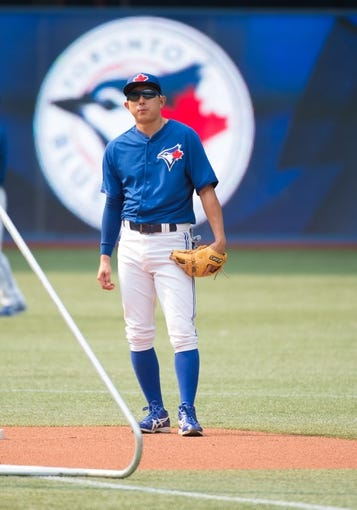 Aug 7, 2014; Toronto, Ontario, CAN; Toronto Blue Jays second baseman Munenori Kawasaki (66) during batting practice before a game against the Baltimore Orioles at Rogers Centre. The Baltimore Orioles won 2-1. Mandatory Credit: Nick Turchiaro-USA TODAY Sports
