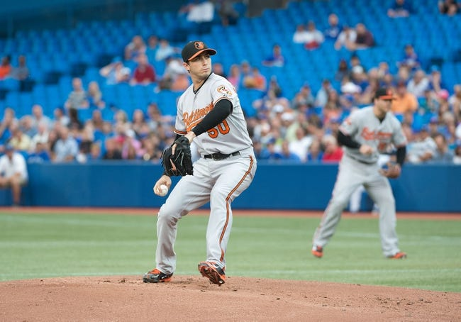 Aug 7, 2014; Toronto, Ontario, CAN; Baltimore Orioles starting pitcher Miguel Gonzalez (50) gets ready to throw a pitch in a game against the Toronto Blue Jays at Rogers Centre. The Baltimore Orioles won 2-1. Mandatory Credit: Nick Turchiaro-USA TODAY Sports