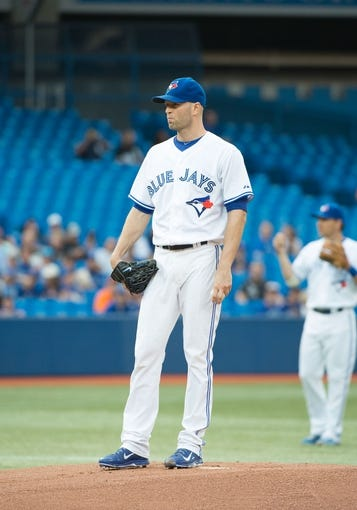 Aug 7, 2014; Toronto, Ontario, CAN; Toronto Blue Jays starting pitcher J.A. Happ (48) gets ready to throw a pitch in a game against the Baltimore Orioles at Rogers Centre. The Baltimore Orioles won 2-1. Mandatory Credit: Nick Turchiaro-USA TODAY Sports