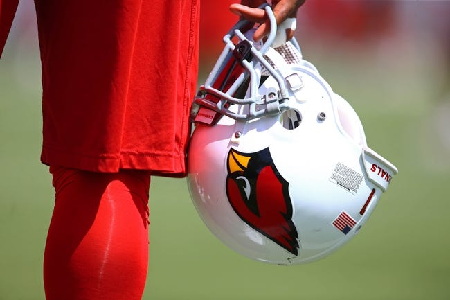 Jun 10, 2014; Tempe, AZ, USA; Detailed view of an Arizona Cardinals helmet during mini camp at the teams Tempe training facility. Mandatory Credit: Mark J. Rebilas-USA TODAY Sports
