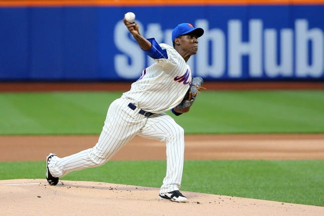 Aug 12, 2014; New York, NY, USA;  New York Mets starting pitcher Rafael Montero (50) pitches during the first inning against the Washington Nationals at Citi Field. Mandatory Credit: Anthony Gruppuso-USA TODAY Sports