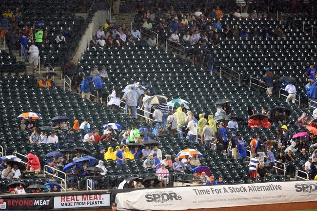 Aug 12, 2014; New York, NY, USA; Fans exit the stands as it rains during the third inning of the game between the New York Mets and the Washington Nationals at Citi Field. Mandatory Credit: Anthony Gruppuso-USA TODAY Sports