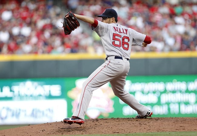 Aug 12, 2014; Cincinnati, OH, USA; Boston Red Sox starting pitcher Joe Kelly (56) pitches during the second inning against the Cincinnati Reds at Great American Ball Park. Mandatory Credit: Frank Victores-USA TODAY Sports