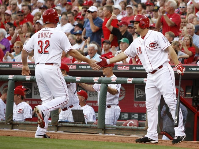 Aug 12, 2014; Cincinnati, OH, USA; Cincinnati Reds right fielder Jay Bruce (32) is congratulated by left fielder Chris Heisey (28) after scoring during the first inning against the Boston Red Sox at Great American Ball Park. Mandatory Credit: Frank Victores-USA TODAY Sports