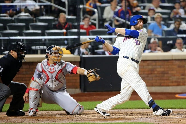 Aug 12, 2014; New York, NY, USA; New York Mets first baseman Lucas Duda (21) singles to deep right during the fourth inning against the Washington Nationals at Citi Field. Mandatory Credit: Anthony Gruppuso-USA TODAY Sports