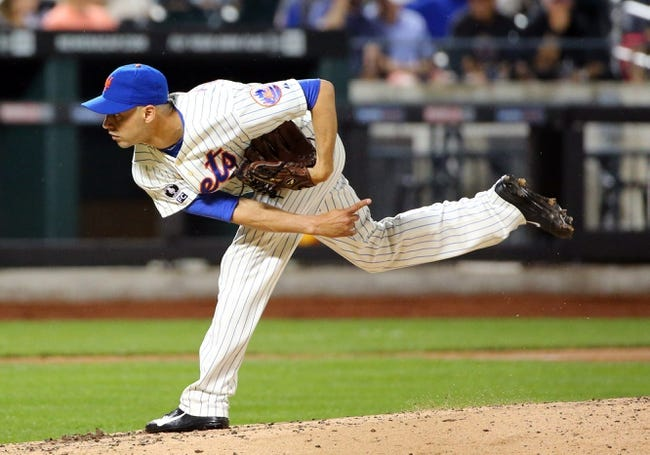 Aug 12, 2014; New York, NY, USA;  New York Mets relief pitcher Carlos Torres (52) delivers a pitch during the seventh inning against the Washington Nationals at Citi Field. Mandatory Credit: Anthony Gruppuso-USA TODAY Sports