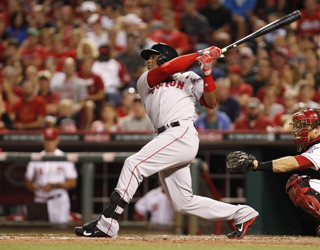 Aug 12, 2014; Cincinnati, OH, USA; Boston Red Sox left fielder Yoenis Cespedes (52) hits the game winning two run home run during the eighth inning against the Cincinnati Reds at Great American Ball Park. The Red Sox defeated the Reds 3-2. Mandatory Credit: Frank Victores-USA TODAY Sports