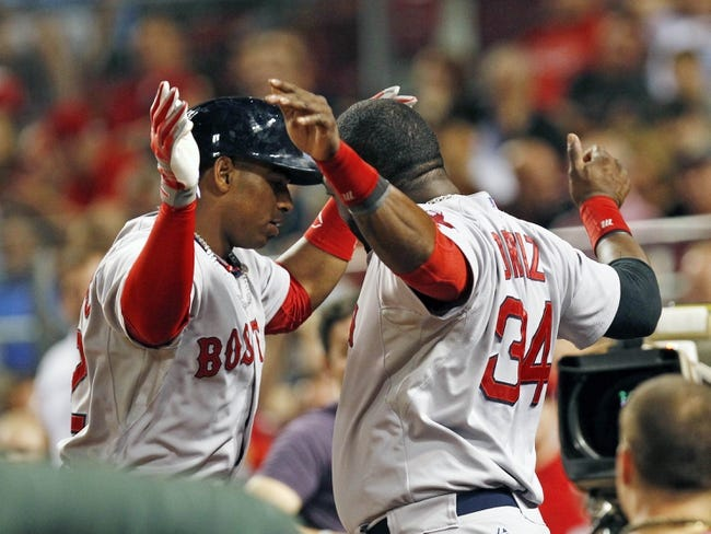 Aug 12, 2014; Cincinnati, OH, USA; Boston Red Sox left fielder Yoenis Cespedes (52) is congratulated by first baseman David Ortiz (34) after hitting a home run during the eighth inning against the Cincinnati Reds at Great American Ball Park. The Red Sox defeated the Reds 3-2. Mandatory Credit: Frank Victores-USA TODAY Sports