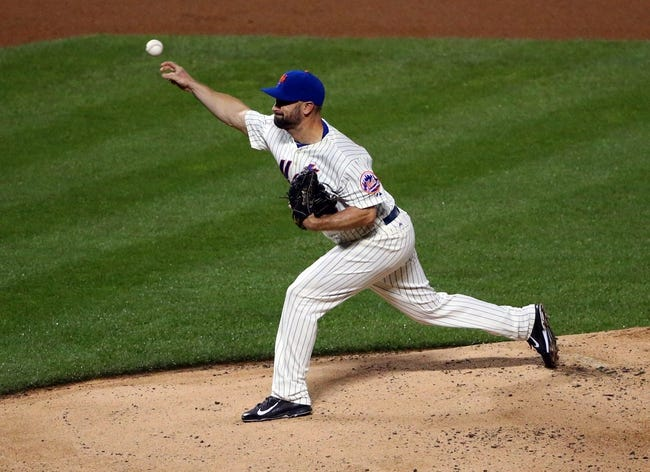 Aug 12, 2014; New York, NY, USA; New York Mets relief pitcher Buddy Carlyle (44) delivers a pitch during the eighth inning against the Washington Nationals at Citi Field. Washington Nationals won 7-1.  Mandatory Credit: Anthony Gruppuso-USA TODAY Sports