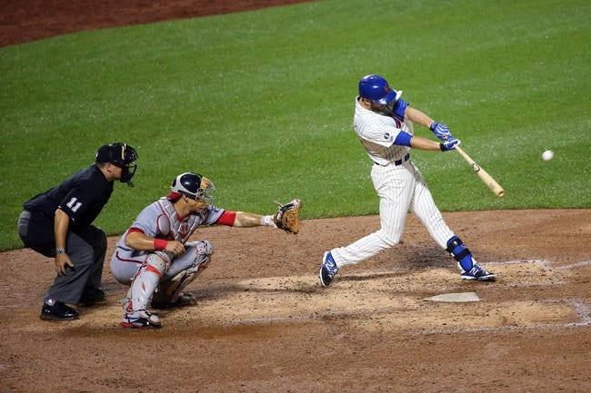 Aug 12, 2014; New York, NY, USA;  New York Mets pinch hitter Eric Campbell (29) hits a sacrifice fly to center allowing a runner to score during the eighth inning against the Washington Nationals at Citi Field. Washington Nationals won 7-1.  Mandatory Credit: Anthony Gruppuso-USA TODAY Sports