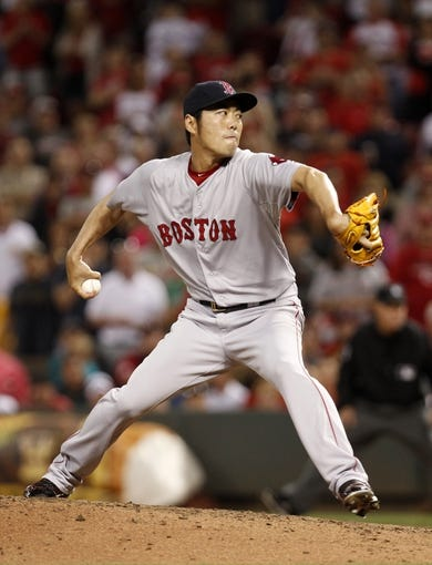 Aug 12, 2014; Cincinnati, OH, USA; Boston Red Sox relief pitcher Koji Uehara (19) pitches during the ninth inning against the Cincinnati Reds at Great American Ball Park. The Red Sox defeated the Reds 3-2. Mandatory Credit: Frank Victores-USA TODAY Sports