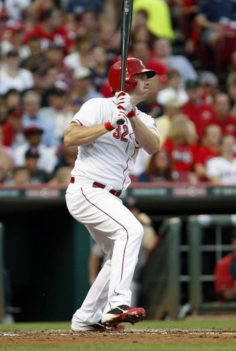 Aug 12, 2014; Cincinnati, OH, USA; Cincinnati Reds right fielder Jay Bruce (32) singles during the third inning against the Boston Red Sox at Great American Ball Park. Mandatory Credit: Frank Victores-USA TODAY Sports