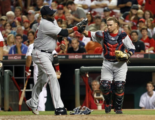 Aug 12, 2014; Cincinnati, OH, USA; Boston Red Sox catcher Christian Vazquez (55) is congratulated by first baseman David Ortiz (34) after making a play during the eighth inning against the Cincinnati Reds at Great American Ball Park. The Red Sox defeated the Reds 3-2. Mandatory Credit: Frank Victores-USA TODAY Sports