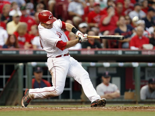 Aug 12, 2014; Cincinnati, OH, USA; Cincinnati Reds catcher Devin Mesoraco (39) singles during the third inning against the Boston Red Sox at Great American Ball Park. Mandatory Credit: Frank Victores-USA TODAY Sports