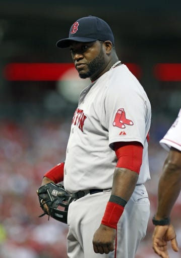 Aug 12, 2014; Cincinnati, OH, USA; Boston Red Sox first baseman David Ortiz (34) on first base during the third inning against the Cincinnati Reds at Great American Ball Park. Mandatory Credit: Frank Victores-USA TODAY Sports