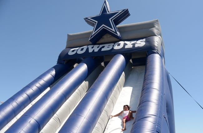 Aug 12, 2014; Oxnard, CA, USA; A youngster on an inflatable slide at scrimmage between the Oakland Raiders and Dallas Cowboys at River Ridge Fields. Mandatory Credit: Kirby Lee-USA TODAY Sports