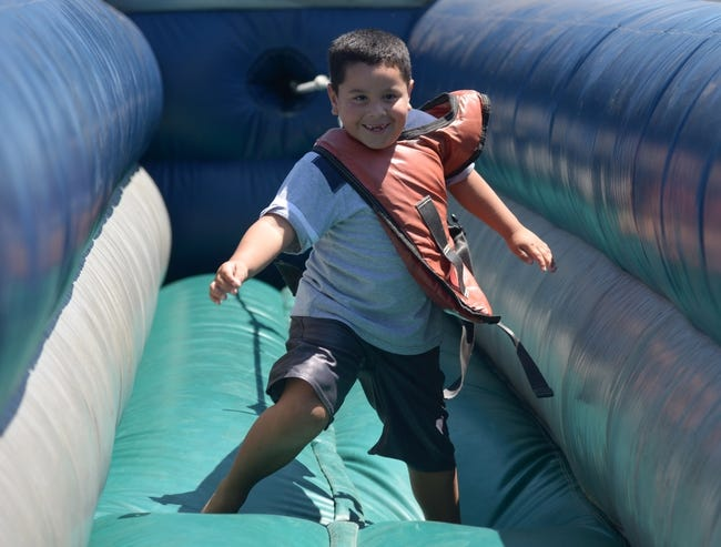 Aug 12, 2014; Oxnard, CA, USA; Jose Rodriguez (age 6) participates in an interactive exhibit at scrimmage between the Oakland Raiders and Dallas Cowboys at River Ridge Fields. Mandatory Credit: Kirby Lee-USA TODAY Sports