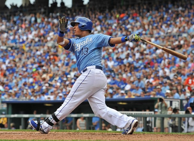 Aug 10, 2014; Kansas City, MO, USA; Kansas City Royals catcher Salvador Perez (13) at bat against the San Francisco Giants during the first inning at Kauffman Stadium. Mandatory Credit: Peter G. Aiken-USA TODAY Sports