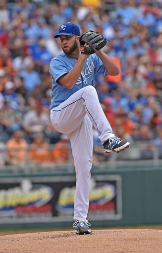 Aug 10, 2014; Kansas City, MO, USA; Kansas City Royals pitcher Danny Duffy (41) delivers a pitch against the San Francisco Giants during the first inning at Kauffman Stadium. Mandatory Credit: Peter G. Aiken-USA TODAY Sports