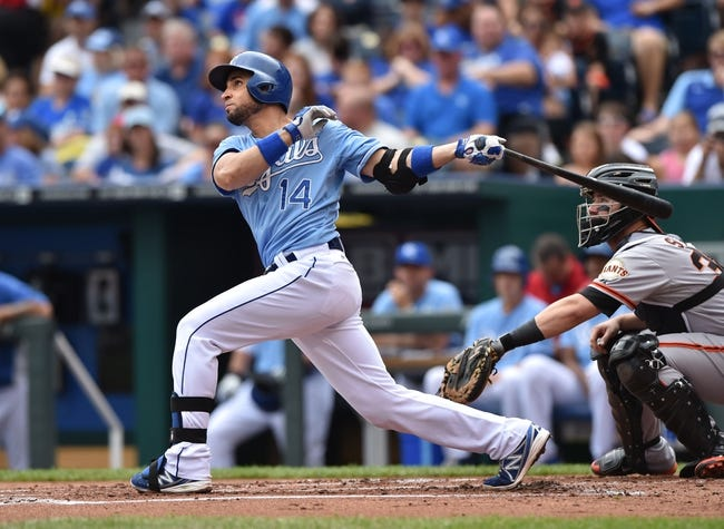 Aug 10, 2014; Kansas City, MO, USA; Kansas City Royals second basemen Omar Infante (14) at bat against the San Francisco Giants during the first inning at Kauffman Stadium. Mandatory Credit: Peter G. Aiken-USA TODAY Sports