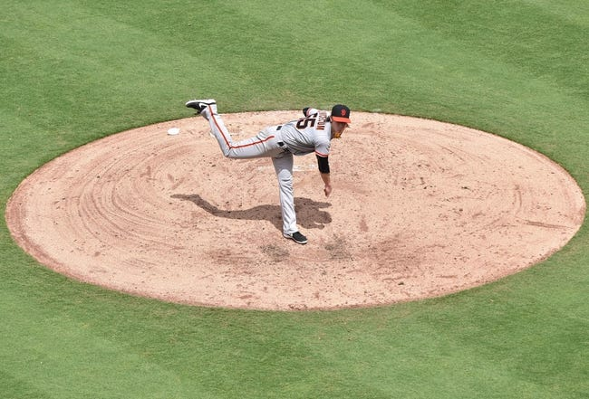 Aug 10, 2014; Kansas City, MO, USA; San Francisco Giants pitcher Tim Lincecum (55) delivers a pitch against the Kansas City Royals during the fourth inning at Kauffman Stadium. Mandatory Credit: Peter G. Aiken-USA TODAY Sports