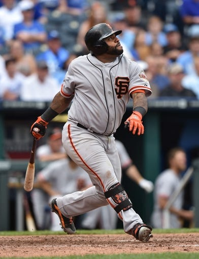 Aug 10, 2014; Kansas City, MO, USA; San Francisco Giants third basemen Pablo Sandoval (48) at bat against the Kansas City Royals during the ninth inning at Kauffman Stadium. Mandatory Credit: Peter G. Aiken-USA TODAY Sports