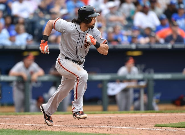 Aug 10, 2014; Kansas City, MO, USA; San Francisco Giants center fielder Angel Pagan (16) runs to first after hitting a single against the Kansas City Royals during the ninth inning at Kauffman Stadium. Mandatory Credit: Peter G. Aiken-USA TODAY Sports