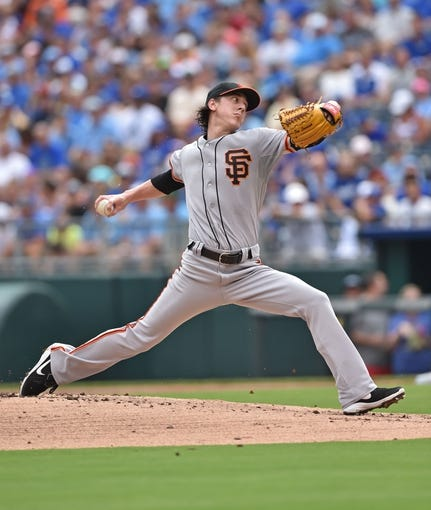 Aug 10, 2014; Kansas City, MO, USA; San Francisco Giants pitcher Tim Lincecum (55) delivers a pitch against the Kansas City Royals during the first inning at Kauffman Stadium. Mandatory Credit: Peter G. Aiken-USA TODAY Sports