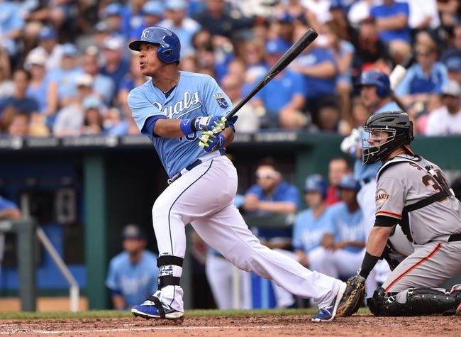 Aug 10, 2014; Kansas City, MO, USA; Kansas City Royals catcher Salvador Perez (13) at bat against the San Francisco Giants during the second inning at Kauffman Stadium. Mandatory Credit: Peter G. Aiken-USA TODAY Sports
