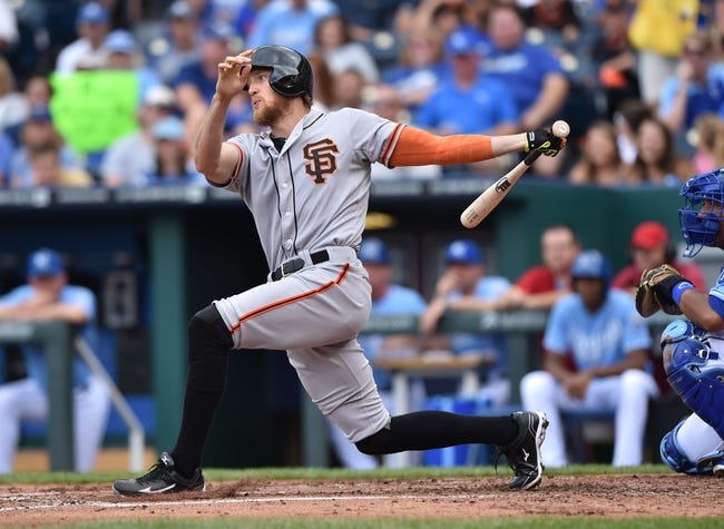 Aug 10, 2014; Kansas City, MO, USA; San Francisco Giants right fielder Hunter Pence (8) at bat against the Kansas City Royals during the third inning at Kauffman Stadium. Mandatory Credit: Peter G. Aiken-USA TODAY Sports