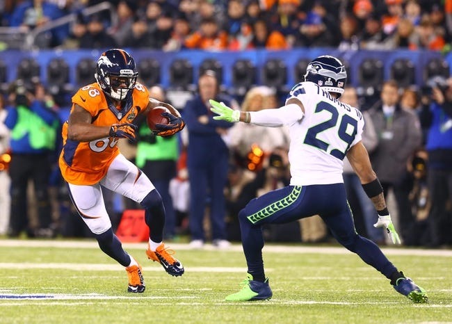 Feb 2, 2014; East Rutherford, NJ, USA; Denver Broncos wide receiver Demaryius Thomas (left) against the Seattle Seahawks in Super Bowl XLVIII at MetLife Stadium.  Mandatory Credit: Mark J. Rebilas-USA TODAY Sports