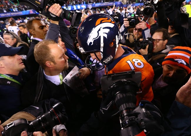 Feb 2, 2014; East Rutherford, NJ, USA; Denver Broncos quarterback Peyton Manning (18) reacts following the game against the Seattle Seahawks in Super Bowl XLVIII at MetLife Stadium.  Mandatory Credit: Mark J. Rebilas-USA TODAY Sports