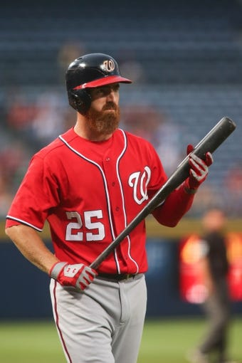 Aug 10, 2014; Atlanta, GA, USA; Washington Nationals first baseman Adam LaRoche (25) prepares to bat against Atlanta Braves starting pitcher Alex Wood (not pictured) in the first inning of their game at Turner Field. The Braves won 3-1. Mandatory Credit: Jason Getz-USA TODAY Sports